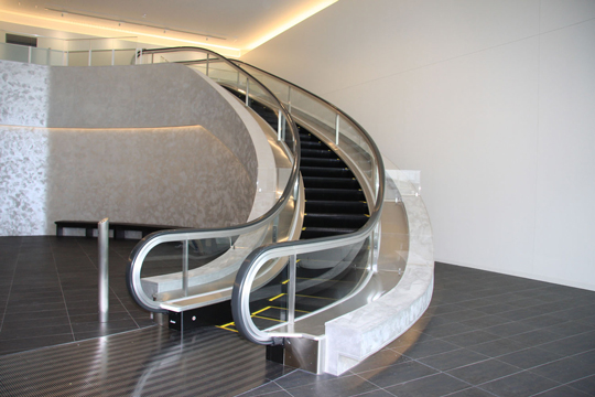A spiral escalator at new training center's entrance